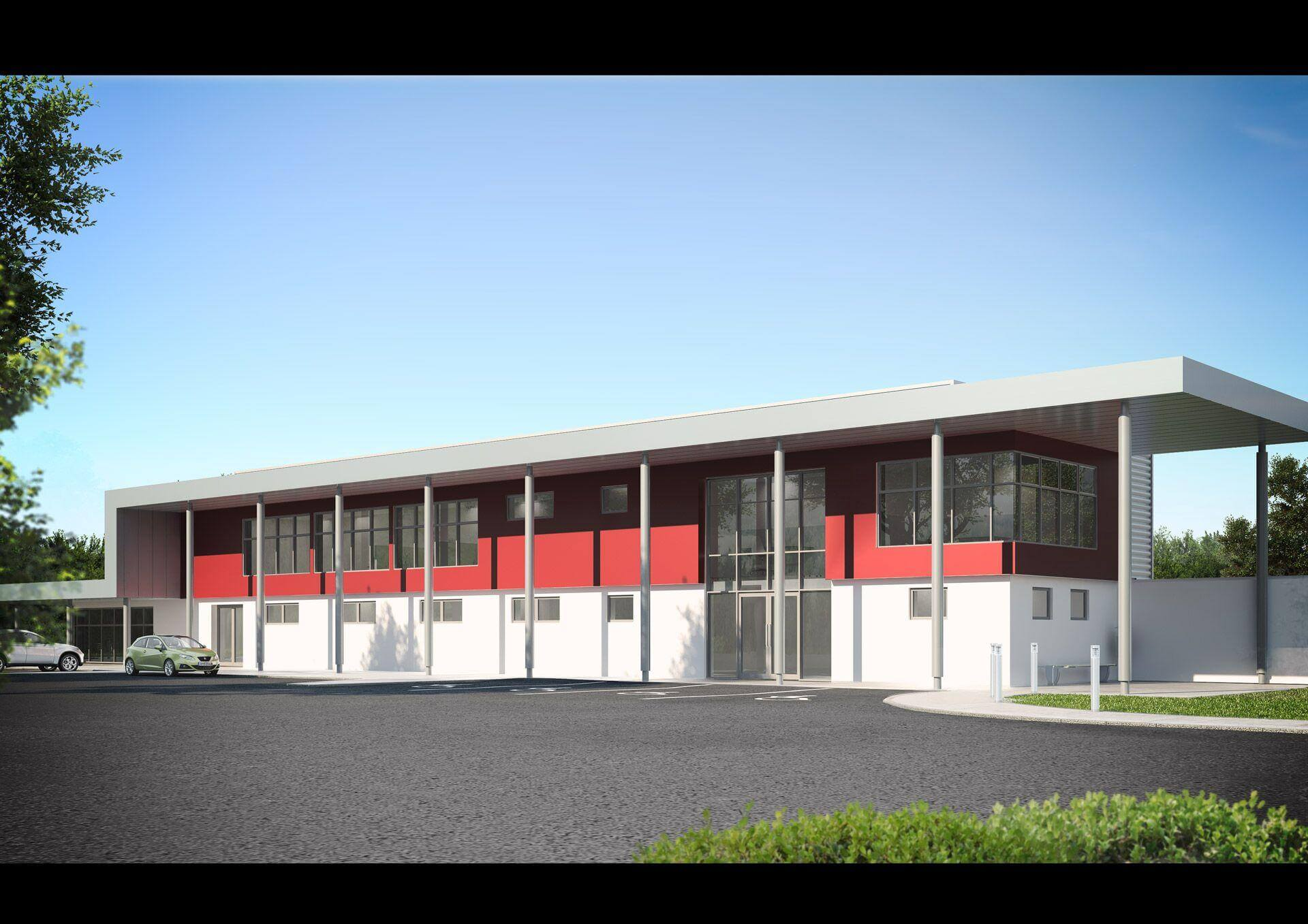 Façade of light industrial building with overhanging double height canopy supported off grey colonnade with red accent wall to first floor office area.