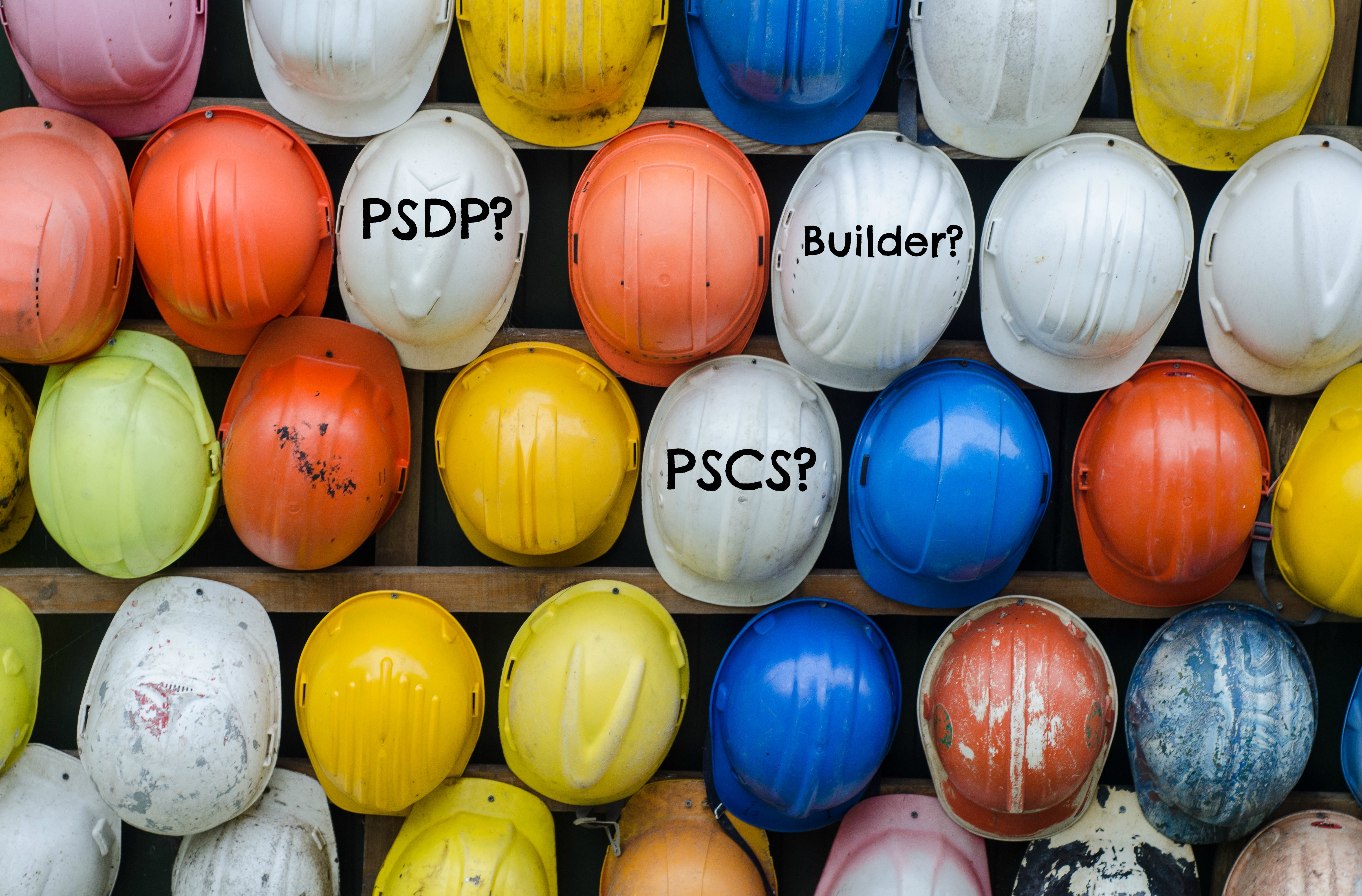 Construction Hard Hats With Psdp And Pscsp And Builder Written In Black Writting On Them