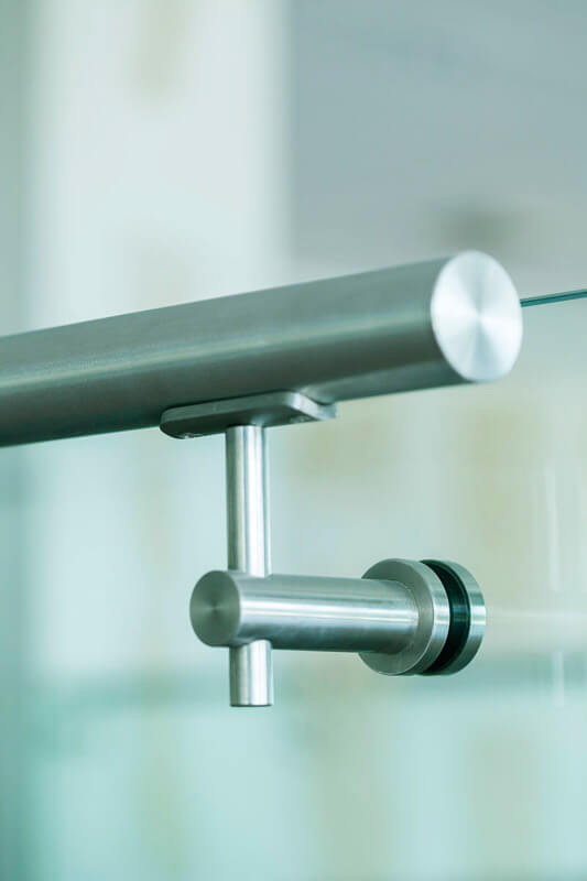 Stainless Steel handrail supported off glass balustrade to external first floor derrace.