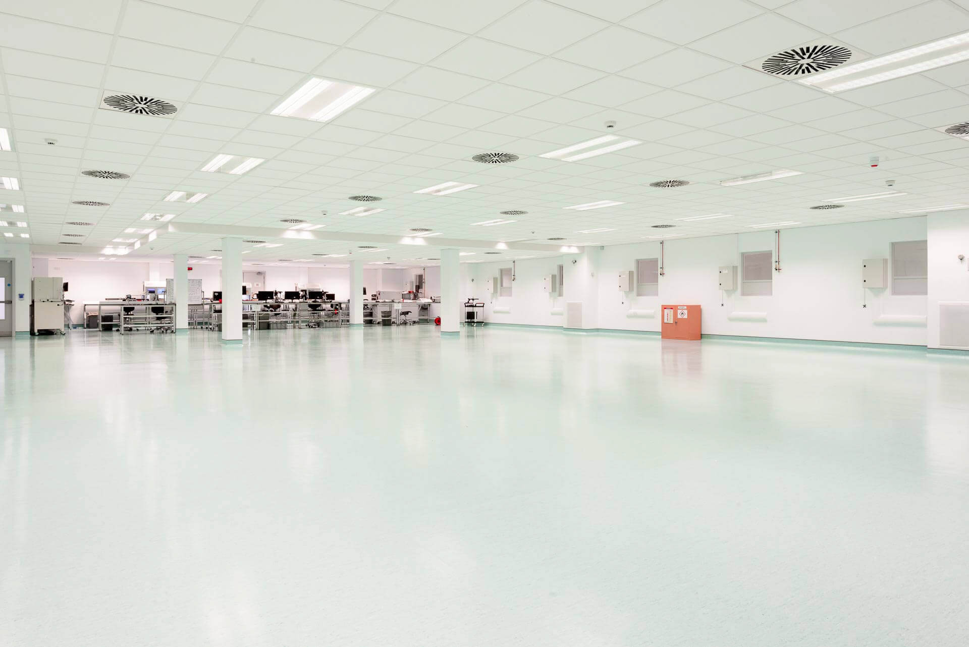 Empty cleanroom prior to client fit-out with MF suspended ceiling and vinyl flooring.