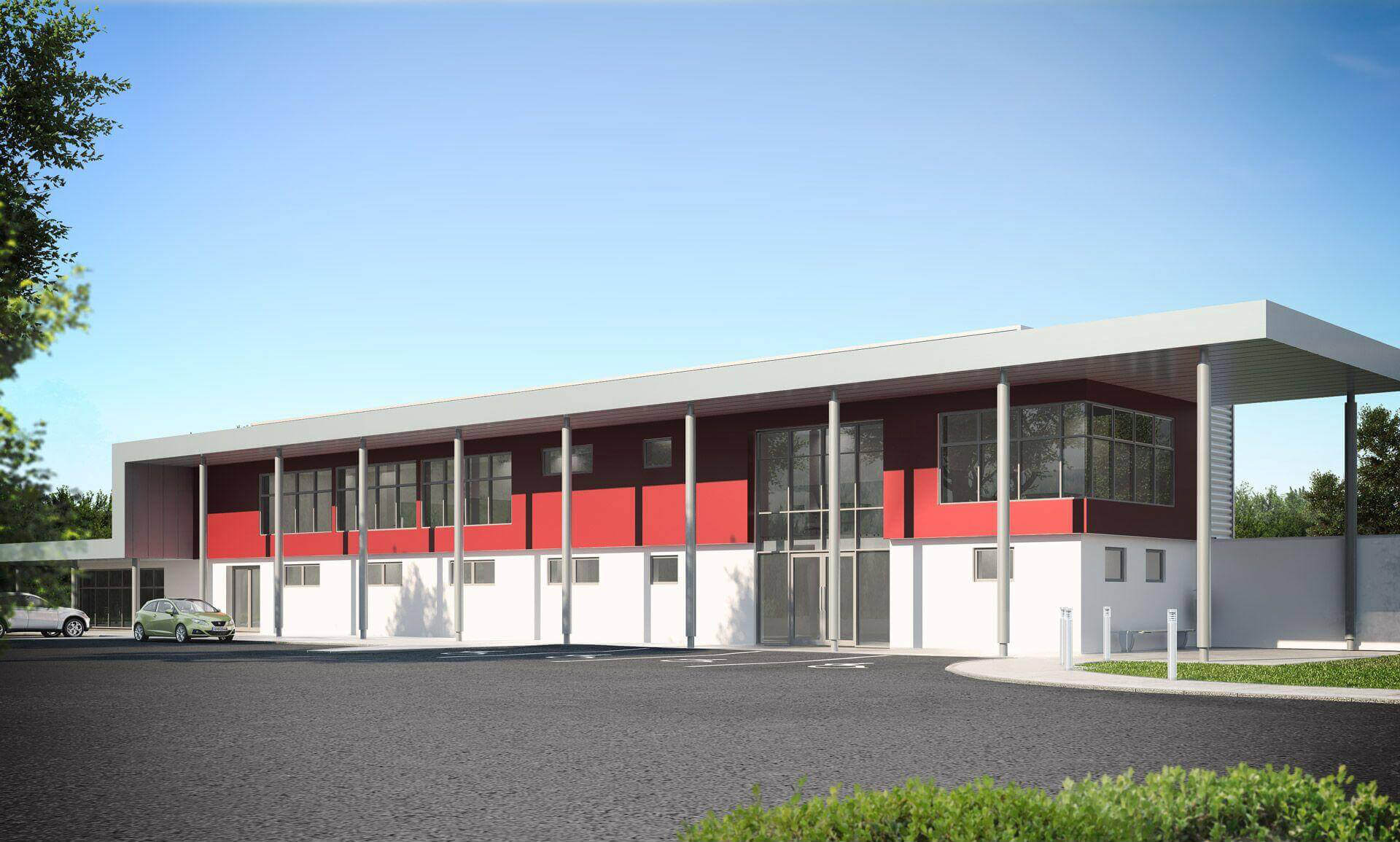 Factory with red feature wall to first floor office area with large canopy over supported off grey columns and floor to ceiling curtain wall to double height entrance area.