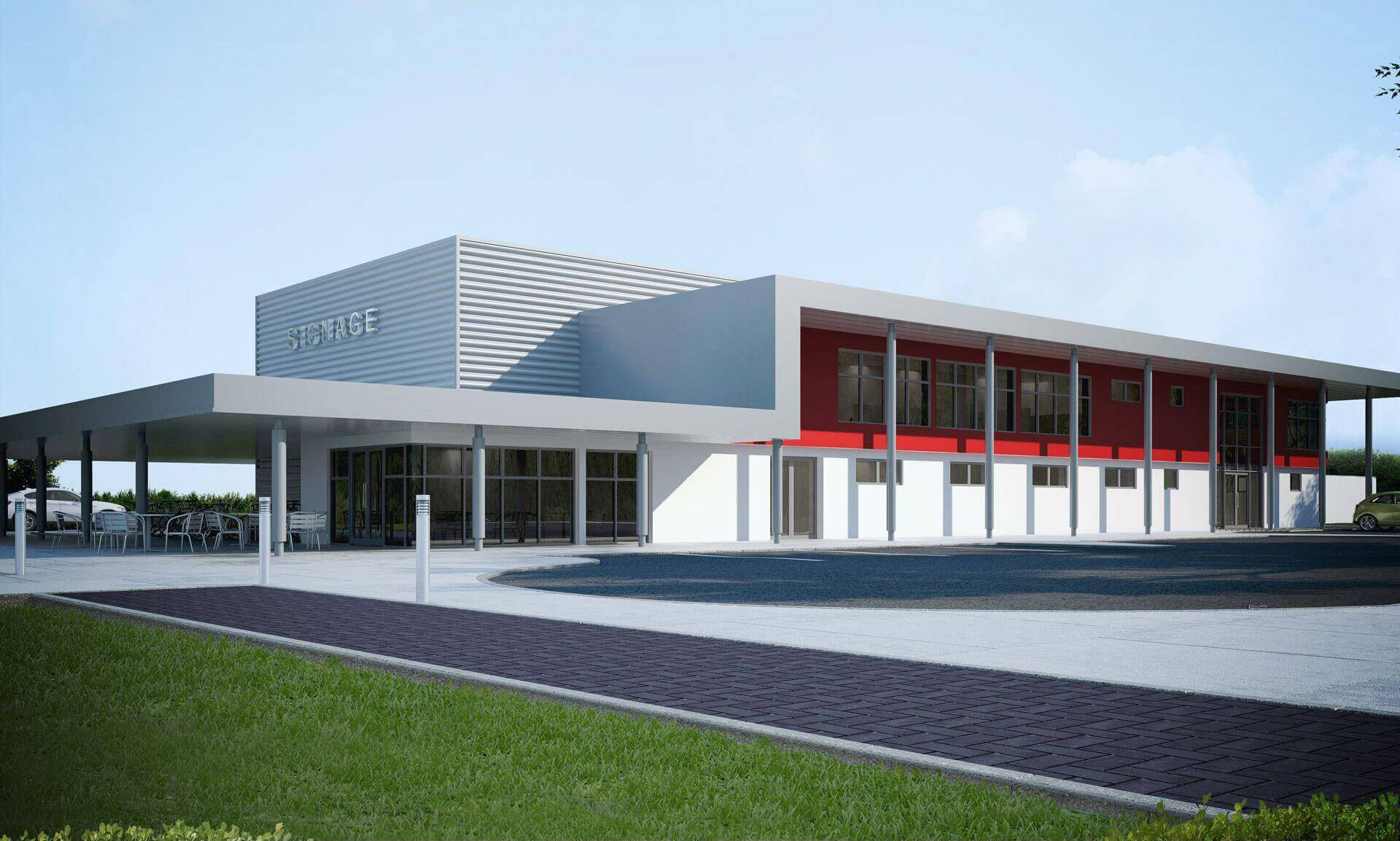 Factory with red feature wall to first floor office area with large canopy over supported off grey columns.