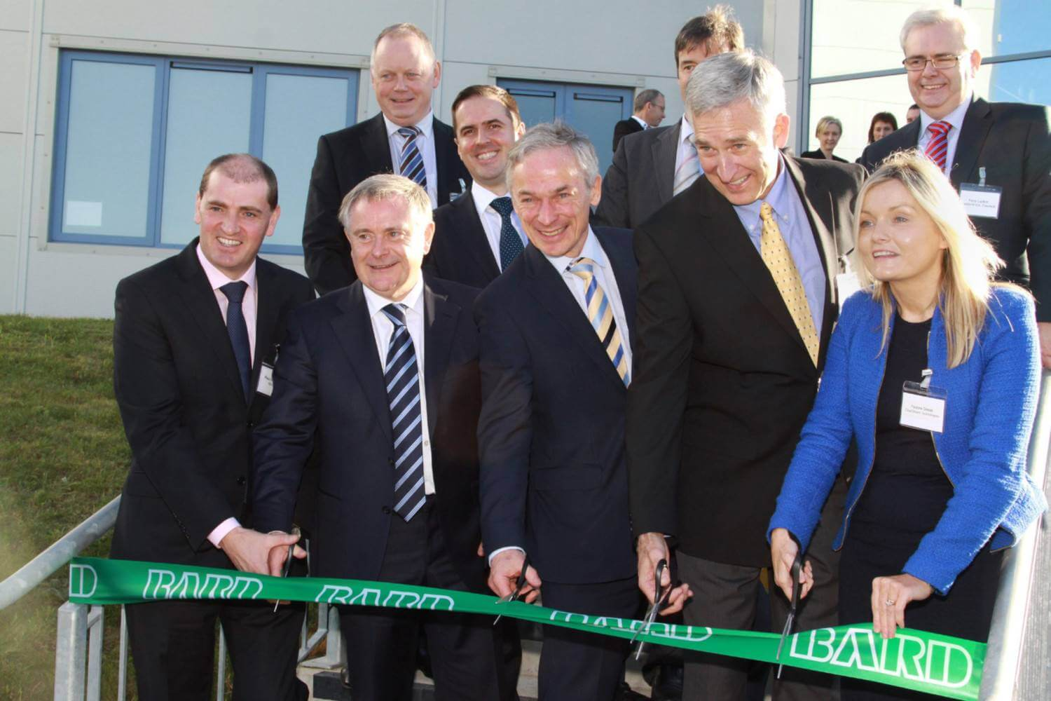 Paul Keogh, Brendan Howlin, Richard Bruton and employees of BARD, Clearstream and the IDA cutting green ribbon to mark opening of new cleanroom extension.