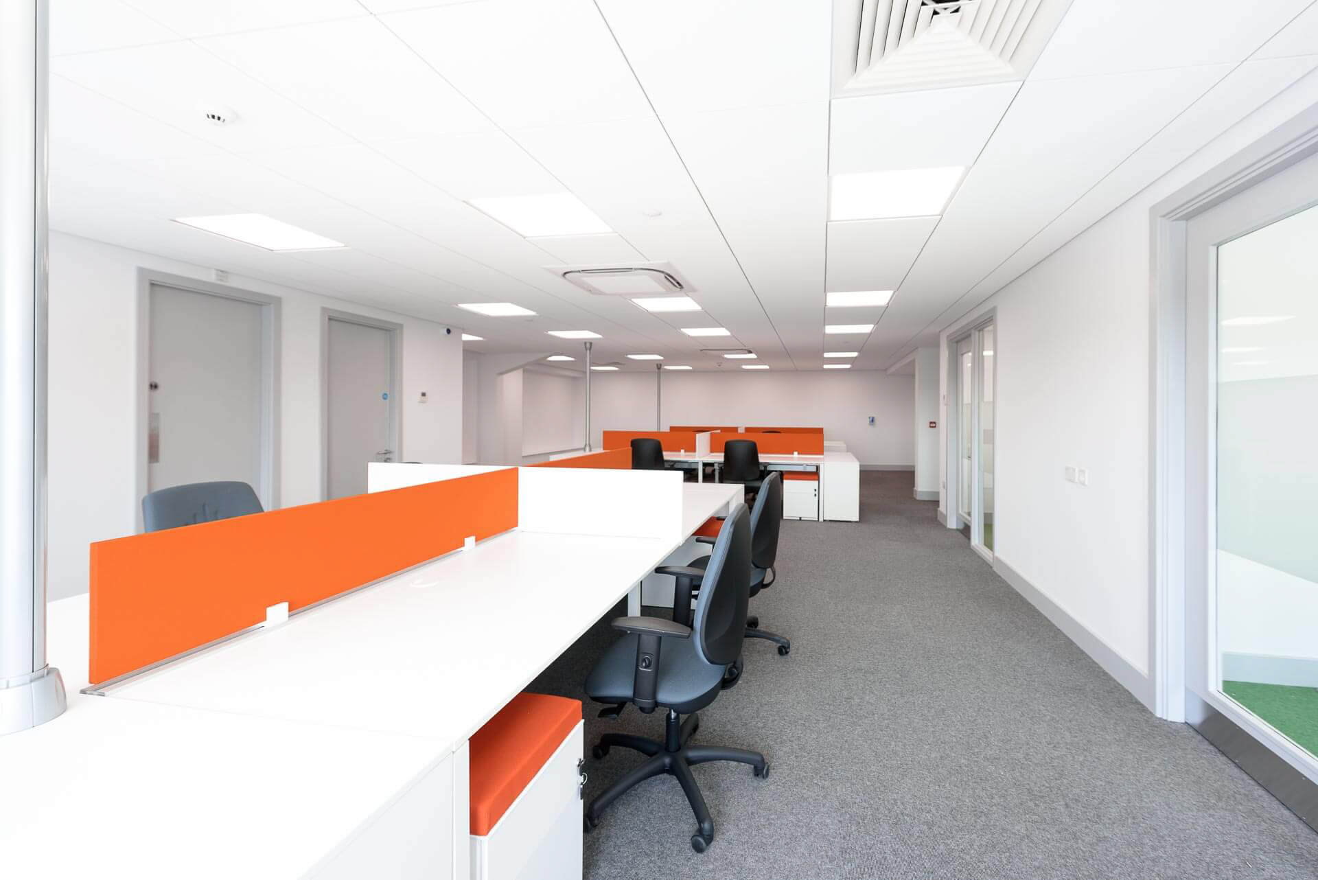 Second floor open plan office areas with cellular offices with glass manifestations to the perimeter.