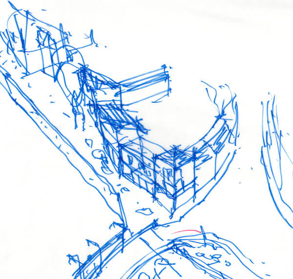 Rough hand sketch of urban design proposal for prominent corner site adjacent to river in blue pen.